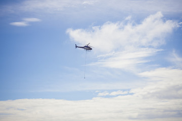 helicopter carry cargo in the sky