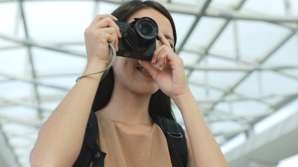 Female photographer taking photo by digital camera