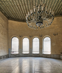 Interior of Agha El-Selehdar Sabil with iron ornate windows, white marble floor, and huge chandelier, Cairo, Egypt