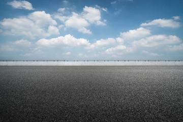asphalt road and blue sky.