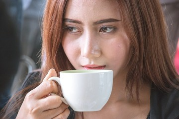 Woman is drinking coffee