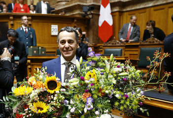 Newly elected Swiss Minister Cassis received bunches of flowers at Swiss parliament in Bern