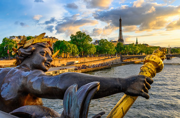 Wall Mural - The Nymph reliefs on the bridge of Alexander III with the Eiffel Tower on background at sunset in Paris, France