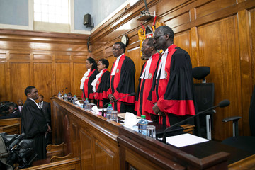 Kenya's Supreme Court judges arrive at the court room before delivering a detailed ruling laying out their reasons for annulling last month's presidential election in Kenya's Supreme Court in Nairobi