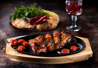 Grilled pork BBQ ribs and glass red wine