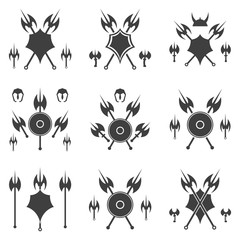 Set of abstract shield and axe silhouette.