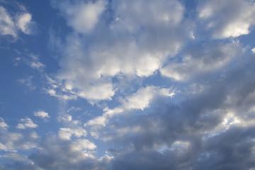 cumulus white clouds against a beautiful blue sky, bizarre patte