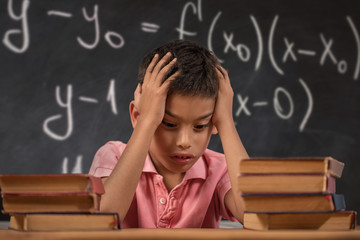 Schoolboy trying to understand formula