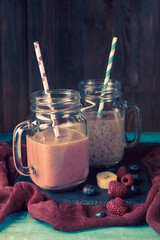 Photo of two jars with smoothies on table