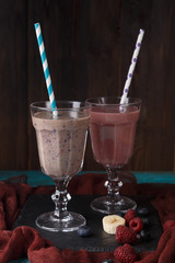 Picture of two wineglasses with straws and smoothies