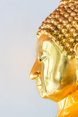 half of a side face buddha's face on white background