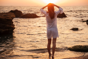 Back view of Brunette woman in light summer dress