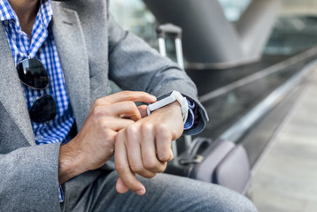 Close-up of businessman using his smartwatch in the city