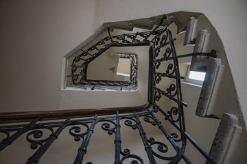 Old staircase in a building in Bucharest, Romania.