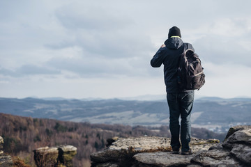 Czechia, Bohemian Switzerland, Tisa, Tyssa Walls, back view of man taking picture