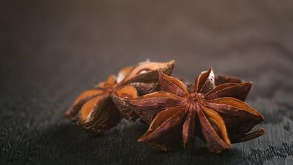 anise stars on old oak table