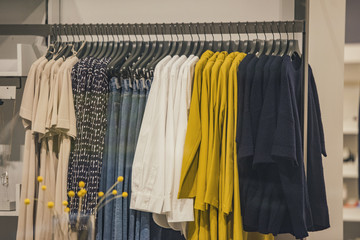 Women clothing on racks in a fashion store