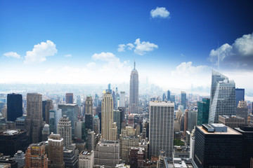 Manhattan panorama in summer time with blue sky, Empire State Building in the center of the picture