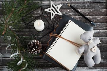 Christmas tree, empty open notebook and xmas decor