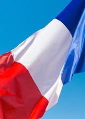 flag of France against the blue sky