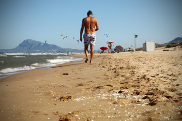 people walking along the shore