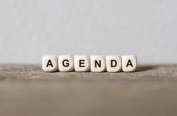 Word AGENDA made with wood building blocks