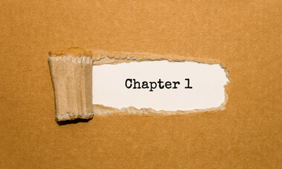 The text Chapter 1 appearing behind torn brown paper
