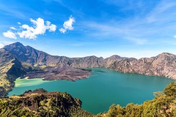 landscape of active volcano Baru Jari, Lake Segara Anak and summit of Rinjani mountain. Lombok island, Indonesia. Wall mural