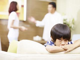 unhappy child and quarreling parents