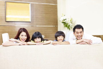 portrait of a happy asian family with two children.