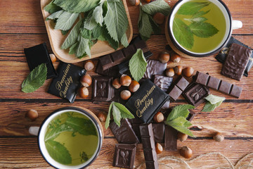 Green tea and chocolate on table