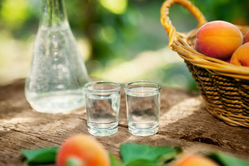Two shot glass with apricot brandy drink