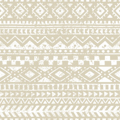 Seamless geometric pattern. Print for your textile. Ethnic and tribal motifs. Gray and white ornament. Grungy texture.