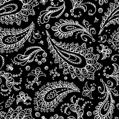 Seamless paisley pattern. Turkish cucumber - trace. White flowers and curls on a black background. Handmade. Prints for textiles. Boho style.