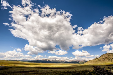 Idyllic view of landscape against cloudy sky