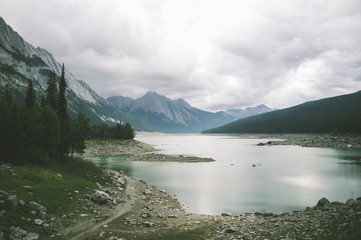 Idyllic view of lake against mountains and stormy clouds at Jasper National Park