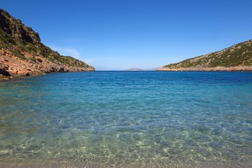 Tranquil blue sea cove with copy space. Symbol of solitude, escape, relaxation.
