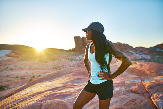 fit african american woman hiker looking out across deset at valley of fire park