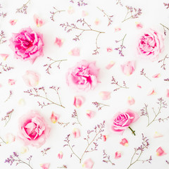 Floral pattern with pink roses, wild flowers and petals on white background. Flat lay, Top view....