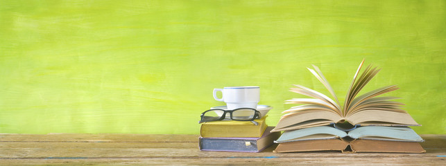 flipped books, cup of coffee,specs, reading, education,literature concept