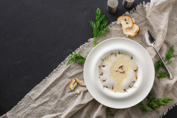 Delicious cream soup with honey fungus top view