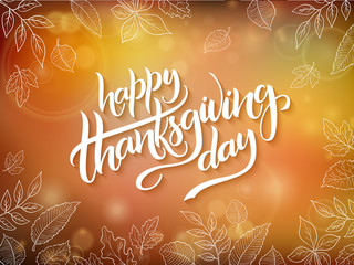 Vector thanksgiving greeting card with hand lettering label - happy thanksgiving day - and autumn doodle leaves on blurred background