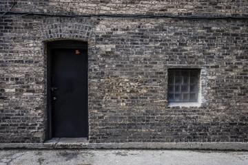 Door and window in brick wall