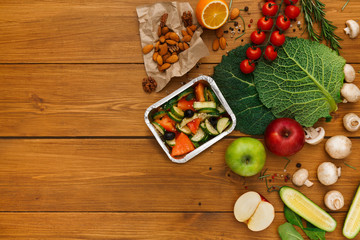 Healthy food delivery background, lunch box on rustic wood