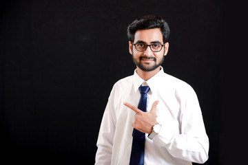 Indian young man showing direction with hand