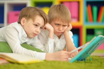 two bored boys doing homework