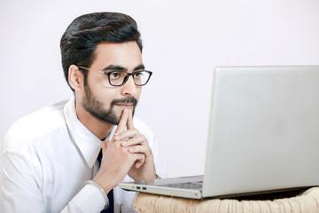 indian man working on laptop