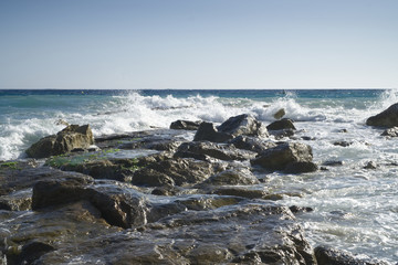 Waves and rock of Mediterranean sea. Costa del Tropical, Spain