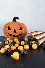 Halloween orange and black popcorn on black and white background