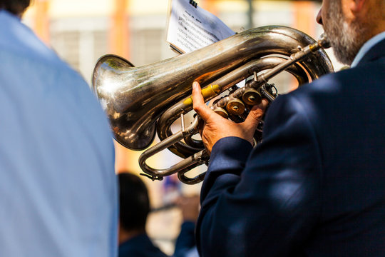 Man playing tuba from behind